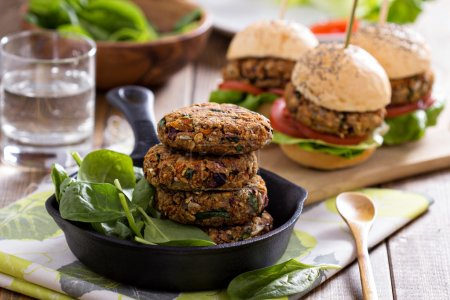 Photo for Vegan burgers with  beans and vegetables served with spinach - Royalty Free Image
