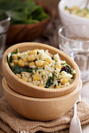 Photo for Warm salad with brown rice, chickpeas, spinach, raisins - Royalty Free Image