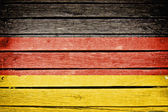 Germany, german flag painted on old wood plank background