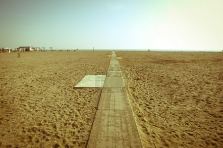 vintage empty beach with a path