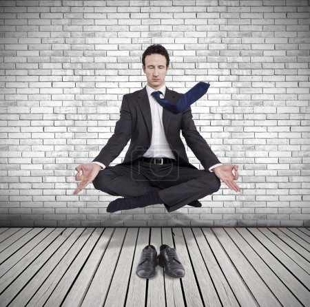 Photo for Young businessman levitating in yoga position, meditation - Royalty Free Image