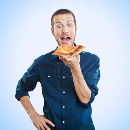 Photo for Portrait of a young beautiful man eating a slice of pizza margherita - Royalty Free Image
