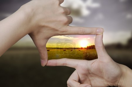 Photo for Out of focus nature and fingers creating a square making the scenery better - Royalty Free Image
