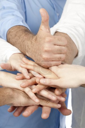 Diverse group of peoples hands together