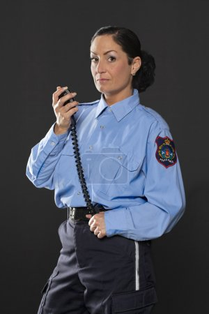 female police holing her cb phone