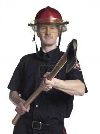 male fire fighter holding axe
