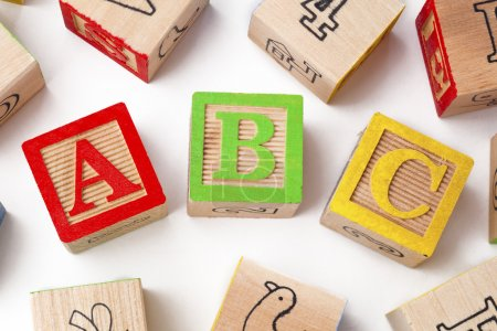 colorful wooden playing cubes over white