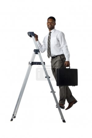 African american businessman climbing the ladder