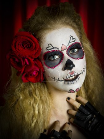 portrait of a ugly woman with face paint and red roses in hair