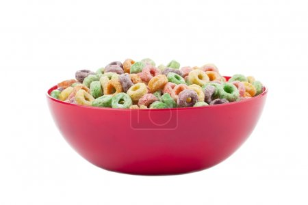 Photo for Close-up image of a red bowl with colorful breakfast cereals isolated on a white background - Royalty Free Image