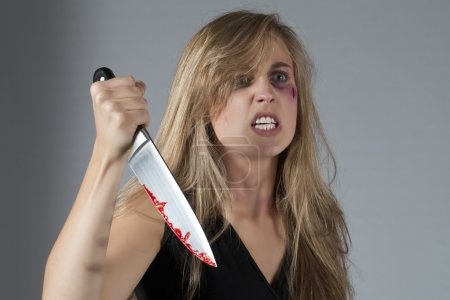 abused mad woman with knife