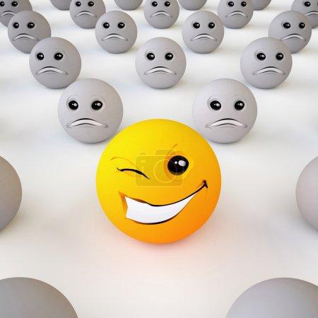 Foto de La bola tridimensional Smiley en el estado de ánimo optimista en medio de pesimistas (sobre fondo blanco) - Imagen libre de derechos