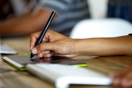 Graphic designer using tablet