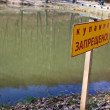 It is forbidden to swim in the forest lake to peop...