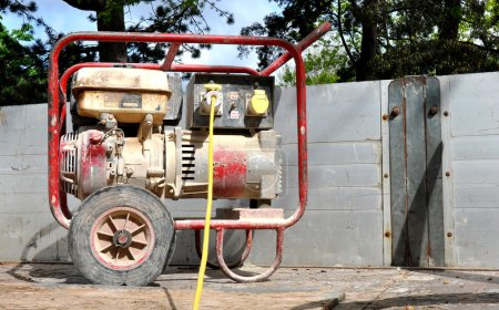 Dusty old petrol driven portable generator on the ...