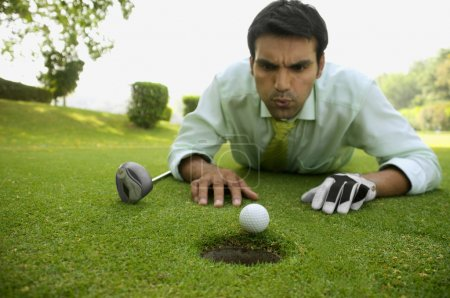 Man with golf ball