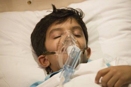 Boy with oxygen mask