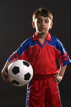 Boy holding a football