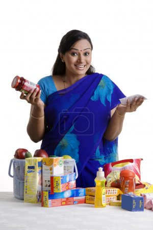 Housewife checking the bill