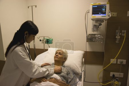Doctor checking on her patient