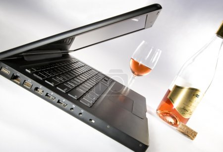 Laptop and glass