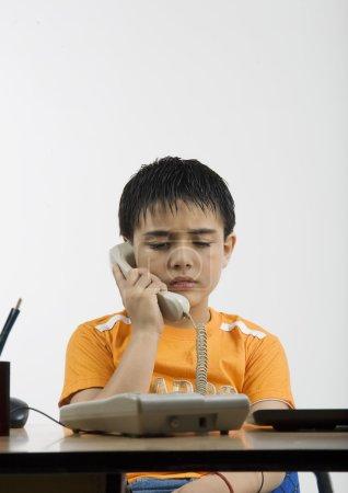 Boy talking on the phone