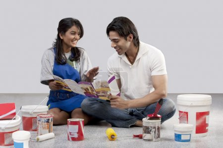 Couple looking at a paint brochure