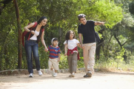 Photo for Portrait of a family in a park - Royalty Free Image