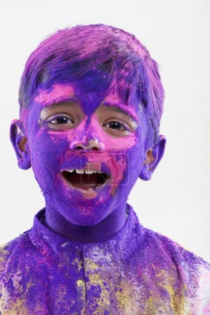 Boy covered with holi colours