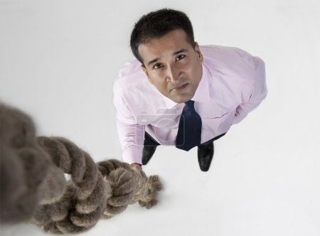 Businessman with rope