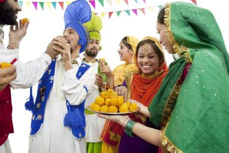 Sikh men and women dancing