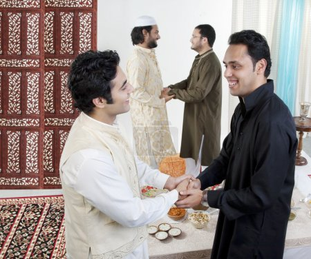 Muslim men greeting each other