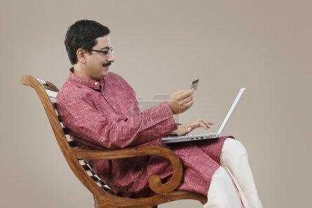 Indian man doing online shopping