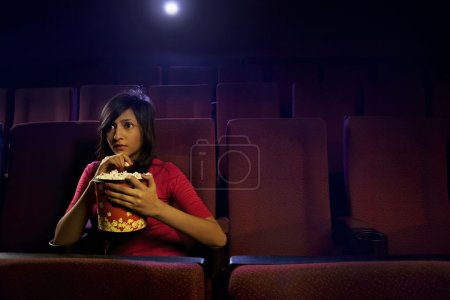 Girl watching a movie