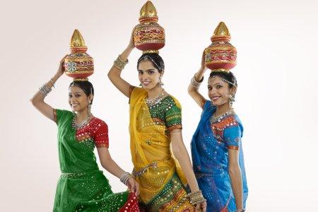 Gujarati women dancing on white background