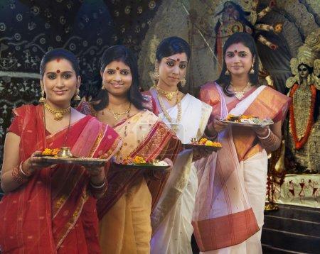 Bengali women celebrating Durga puja