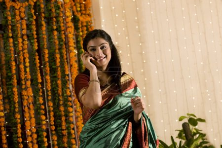 South Indian woman talking on a mobile phone