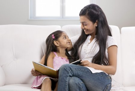 Mother and daughter with a story book