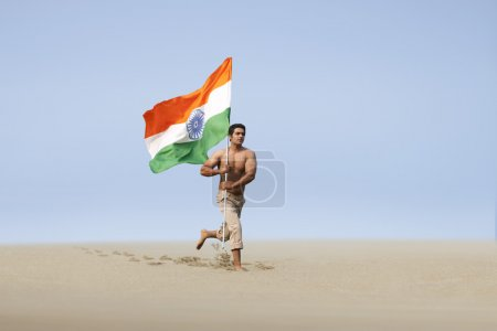 Bare chested man running with the Indian flag