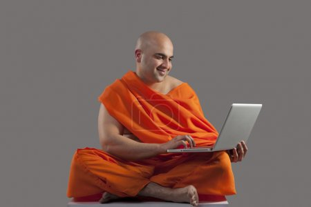 Monk with a laptop