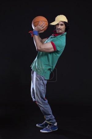 Young man throwing basket ball