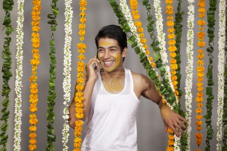 Indian groom talking on a mobile phone