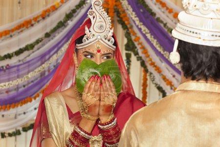 Bengali bride hiding her face