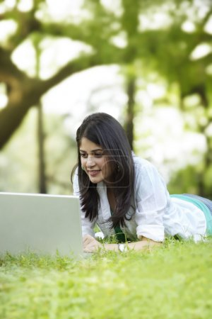 Young woman using laptop on campus