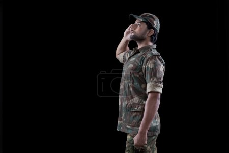 Male military soldier saluting