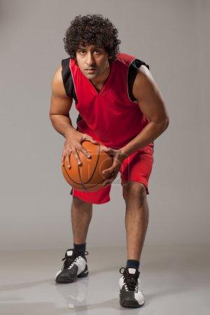 Young man playing basket ball