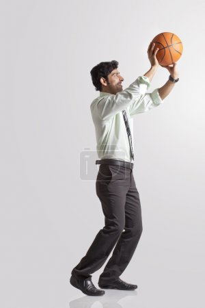 Young man catching basket ball