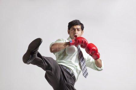 Businessman wearing gloves