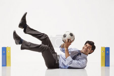 Businessman practicing football skills