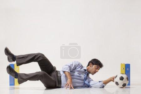 Businessman practicing football skills